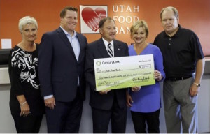 Jackie Lalor, Marketing, Communications Strategiest for CenturyLink Utah (3rd from Left) joins VP Jeremy Ferkin in awarding $6,844 and 1,000 cans of food to the Utah Food Bank on July 29, 2015, together with Utah Governor Gary Herbert